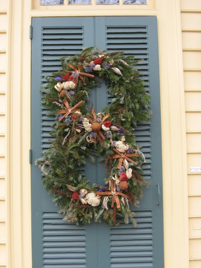 Each Christmas season, residents of Colonial Williamsburg compete for prizes, and praise, by creating remarkable decorations for their doors and windows using only materials that would have been available in the 1700s. Double wreaths or a figure eight? (Susan Reimer/Baltimore Sun)