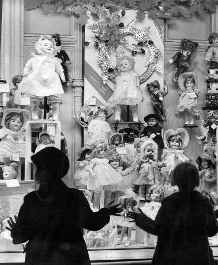 Children stare in the window at dolls. (A. Aubrey Bodine/Baltimore Sun)
