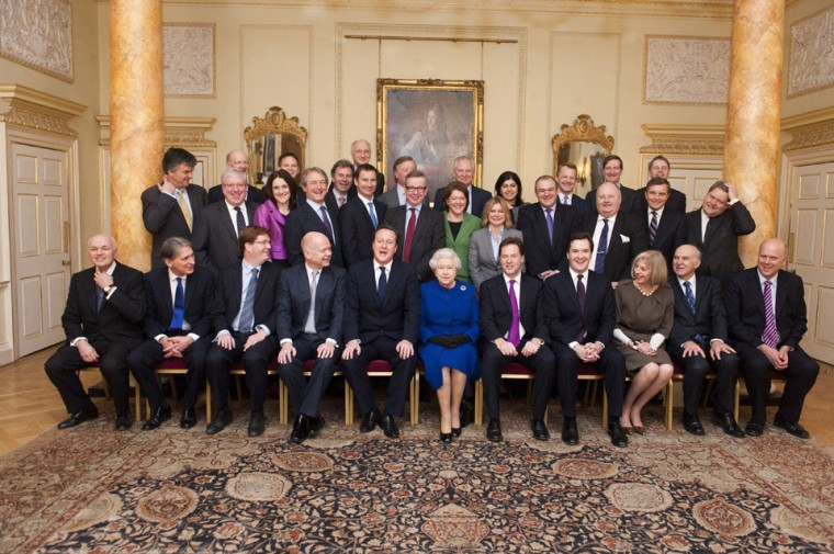 Britain's Queen Elizabeth II (C) sits flanked by British Prime Minister David Cameron (L) and Deputy Prime Minister Nick Clegg (R) as members of the Cabinet pose for a family picture at No 10 Downing Street in central London. Queen Elizabeth II attended a British Cabinet meeting on December 18, the first such visit in more than a century, to mark her diamond jubilee. Historically, monarchs used to chair Cabinet meetings but the last one to exercise their right to attend was queen Victoria, Queen Elizabeth's great-great grandmother, who died in 1901.(Pool/ Jeremy Selwyn/AFP/Getty Images)