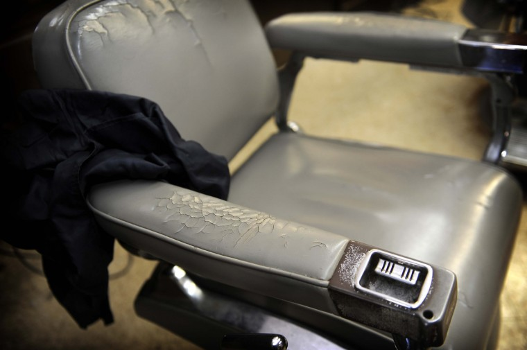 One of the chairs at Gennuso's Barbershop on York Road shows its age as it sits waiting for a customer. (Barbara Haddock Taylor/Baltimore Sun