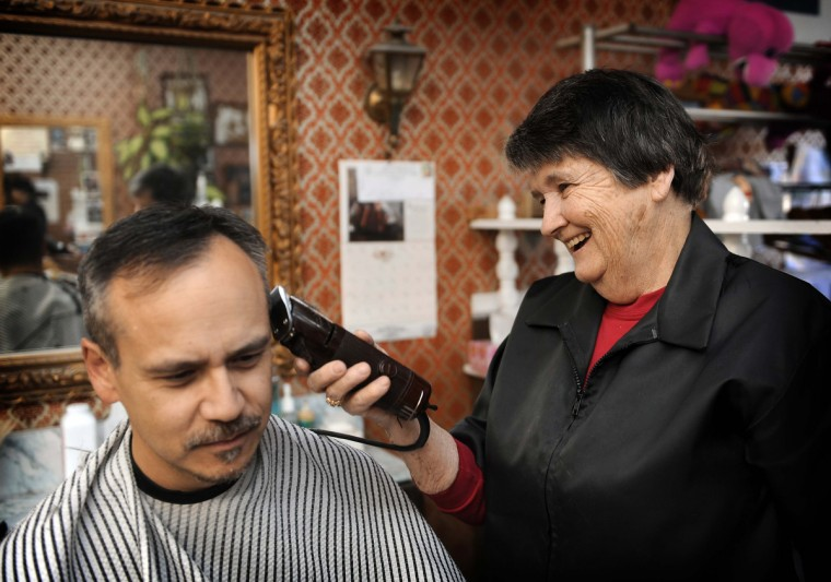 """Barber Annette Jones, who has been a barber for 49 years, uses a clipper on regular customer Louis Panlilio of Baltimore. Mr. Panlilio said about the shop """"It's fast, friendly and they do a good job. I'd rather go to a locally owned business than a big franchise."""" (Barbara Haddock Taylor/Baltimore Sun)"""