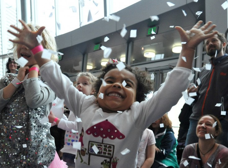 Stella Rose Dorazio, 3, raises her arms in celebration at the Maryland Science Center's noon New Year's Eve celebration.