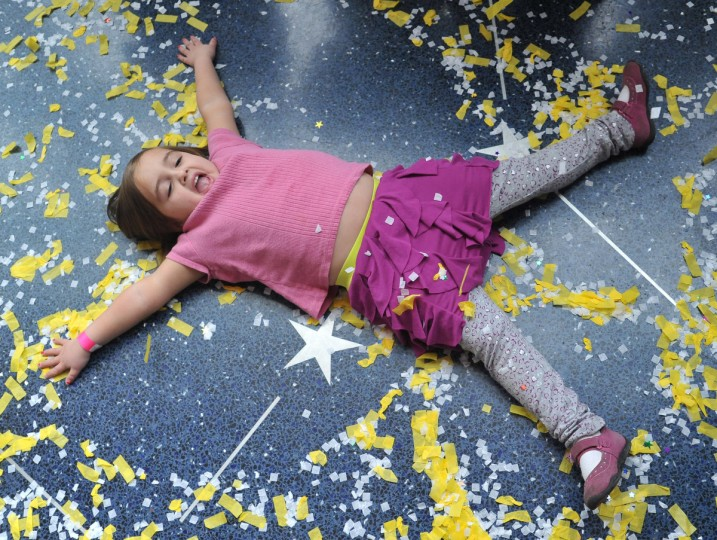 Madeleine Gedansky, 4 1/2, plays in the confetti at the Maryland Science Center's noon New Year's Eve celebration.