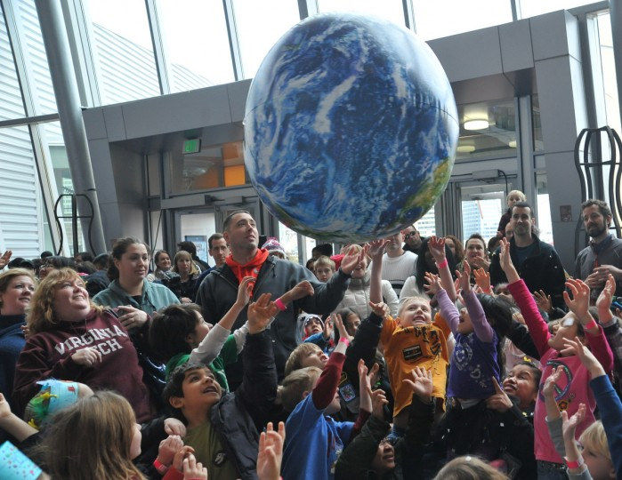 Children ring in 2013 early at the Maryland Science Center's noon New Year's Eve celebration.