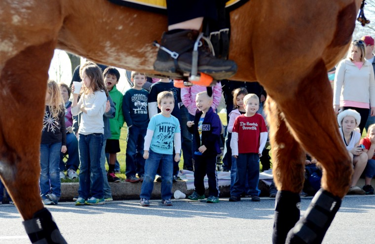 Children watch the Lisbon Old Fashion Christmas Horse Parade on Saturday. (Jon Sham/BSMG)