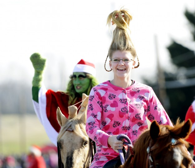"Brooke Green, 15, of Mount Airy, dressed as Cindy Lou Who from Dr. Seuss' ""How The Grinch Stole Christmas,"" rides a horse through the parade with her mom, Irene Savage, who is dressed as The Grinch. (Jon Sham/BSMG)"