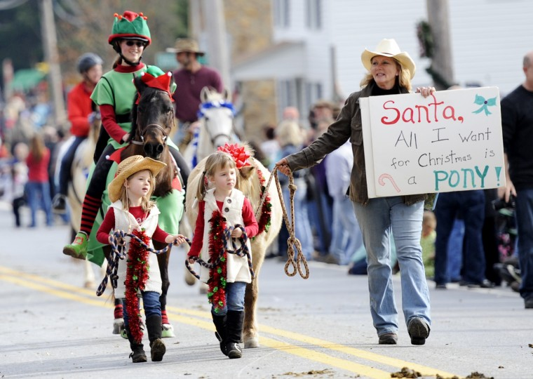 "Caden, left, and Kendall, who are 4-year-old twins, lead Shetland horse ""Simba"" through the parade. (Jon Sham/BSMG)"