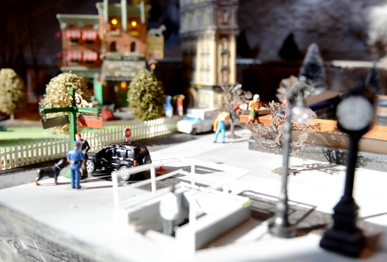 A section of the train garden at the Glen Avenue fire station in Mount Washington shows a police officer and dog talking to a man next to a Jeep. (Jon Sham/BSMG)