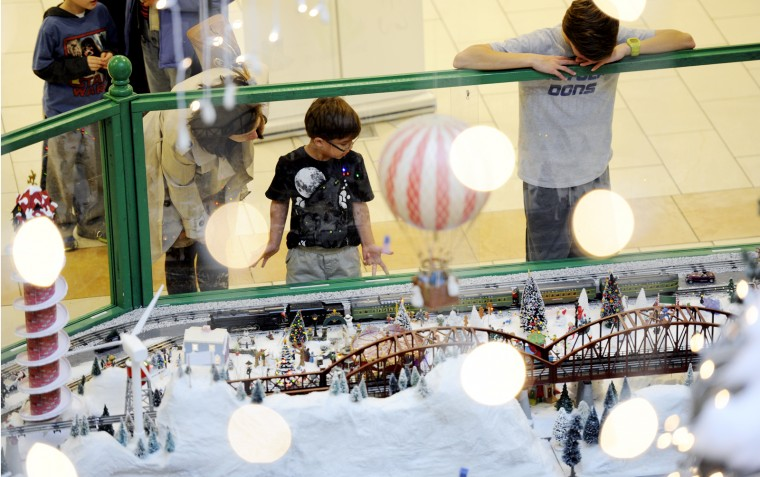 Dozens of children stopped to look at the train garden at The Shops at Kenilworth Friday, which had several strands of icicle lights hanging above it. (Jon Sham/BSMG)