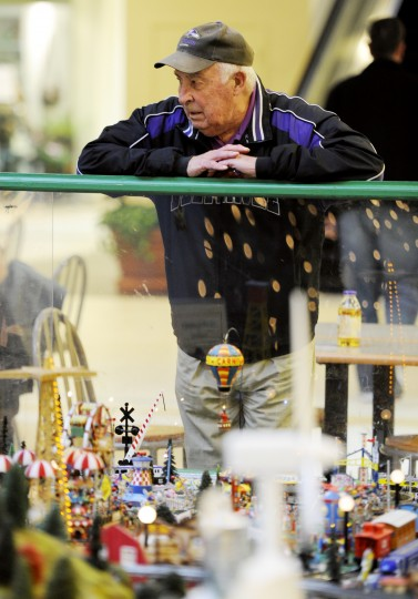 Bob Filippelli, of Reisterstown, stops for a moment to look at the train garden at Kenilworth. His father had been an engineer, which drew him to it on Friday. (Jon Sham/BSMG)
