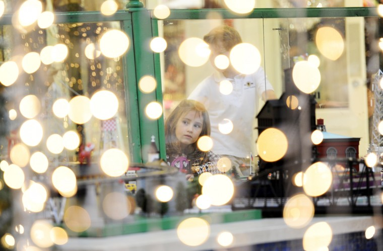 Children are seen looking at the train garden through the draping Christmas lights at The Shops at Kenilworth. (Jon Sham/BSMG)