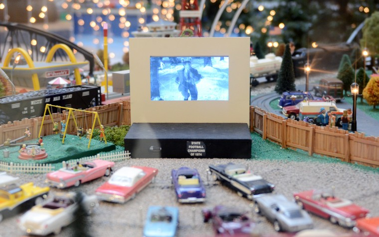 "Frank Capra's holiday classic ""It's a Wonderful Life"" plays on the screen at a miniature drive-in movie theater at Kenilworth's train garden. (Jon Sham/BSMG)"