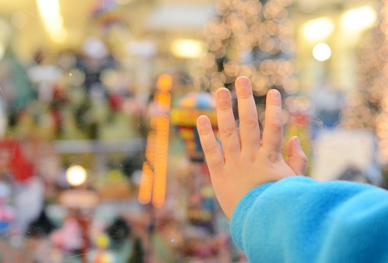 Sawyer Meyer, 4, of Timonium, presses his hand against the glass barrier surrounding the train garden at The Shops at Kenilworth. (Jon Sham/BSMG)