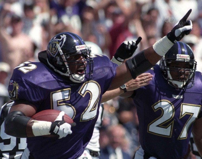 Ravens rookie Ray Lewis (52) celebrates after intercepting a pass in the 1996 season opener against the Oakland Raiders at Memorial Stadium. (Kenneth K. Lam/Baltimore Sun Photo)
