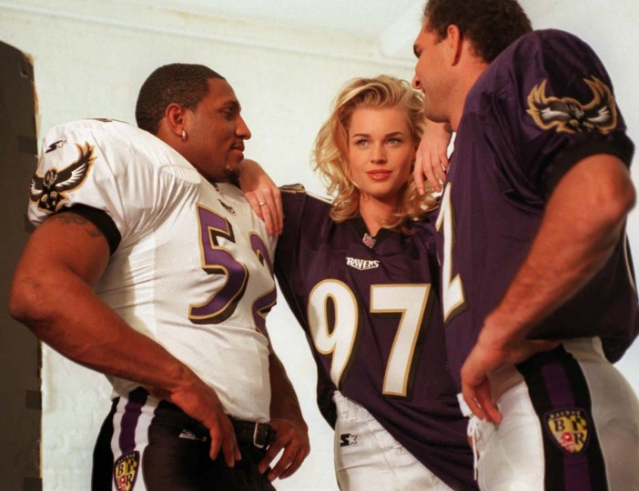 Ravens linebacker Ray Lewis (left) and quarterback Vinny Testaverde (right) pose in the team's new uniforms with model Rebecca Romijn. (Hillery Smith/Baltimore Sun Photo)