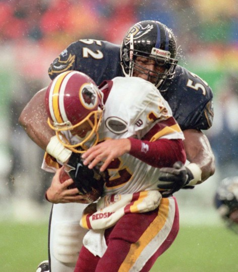 Ray Lewis sacks Redskins quarterback Gus Frerotte in the fourth quarter of the Ravens' 20-17 win Oct. 26, 1997, in Landover, Md. (Lloyd Fox/Baltimore Sun Photo)