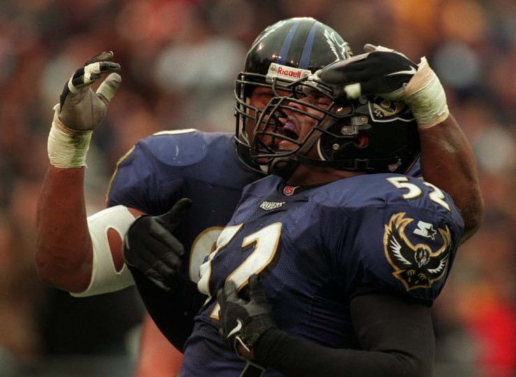 Ray Lewis and Rob Burnett celebrate after a defensive stop in the Ravens' 13-10 win over Oakland on Nov. 8, 1998. (John Makely/Baltimore Sun Photo)