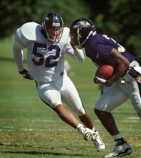 Ray Lewis chases down running back Priest Holmes during a 1999 training camp practice in Westminster. (Lloyd Fox/Baltimore Sun Photo)