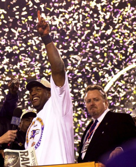 Ray Lewis celebrates on the podium after the Ravens' 34-7 victory in Super Bowl XXXV as John Modell looks on. Lewis was named Super Bowl MVP, becoming the first middle linebacker to win the award. (Gene Sweeney Jr./Baltimore Sun Photo)