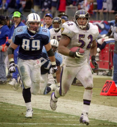 Ray Lewis outruns the Tennessee Titans' Frank Wycheck for a fourth-quarter touchdown during the Ravens' 24-10 win in the divisional round of the playoffs on Jan. 7, 2001. Lewis returned the interception of Titans quarterback Steve McNair 50 yards for the first touchdown of his career. (Doug Kapustin/Baltimore Sun Photo)