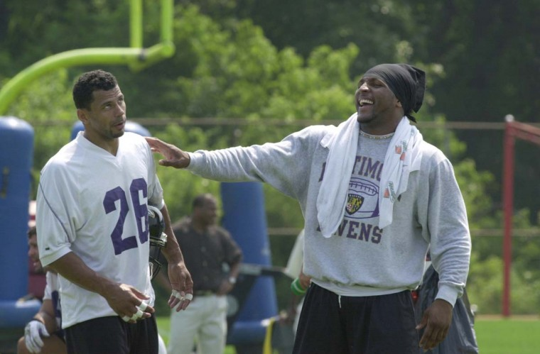 Ray Lewis (left) and Rod Woodson share a laugh during minicamp practice on June 13, 2001. (John Makely/Baltimore Sun Photo)