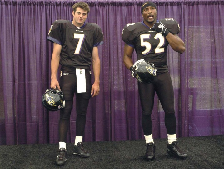 Quarterback Kyle Boller (left) and linebacker Ray Lewis model the Ravens' new black uniforms on June 16, 2004. (David Hobby/Baltimore Sun Photo)