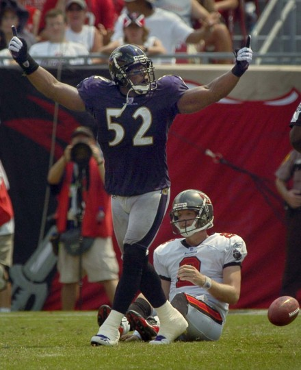 Ray Lewis celebrates after Tampa Bay Buccaneers quarterback Chris Simms (back) is sacked by Bart Scott in the Ravens' 27-0 win in the 2006 season opener. (Karl Merton Ferron/Baltimore Sun Photo)
