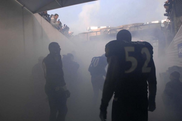 Ray Lewis and his teammates wait in the smoke during introductions before a 19-7 victory over the Buffalo Bills in the final game of the 2006 regular season. (John Makely/Baltimore Sun Photo)