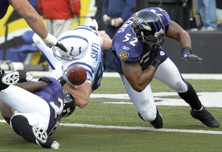 Ray Lewis hits Indianapolis Colts tight end Tom Santi, forcing a fumble near the goal line in Indianapolis' 17-15 win on Nov. 22, 2009. (Karl Merton Ferron/Baltimore Sun Photo)