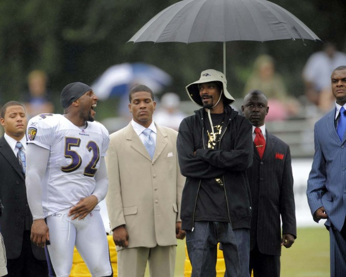 The Westminster Dogg Show: Ray Lewis talks with rapper Snoop Dogg (third from right) during the artist's 2009 visit to Ravens training camp at McDaniel College. (Karl Merton Ferron/Baltimore Sun Photo)