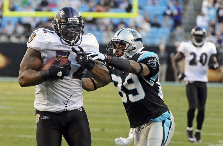 Ray Lewis (left) drags the Carolina Panthers' Steve Smith into the end zone as he scores a touchdown after an interception on Nov. 21, 2010. The Ravens won, 37-13. (Kenneth K. Lam/Baltimore Sun Photo)