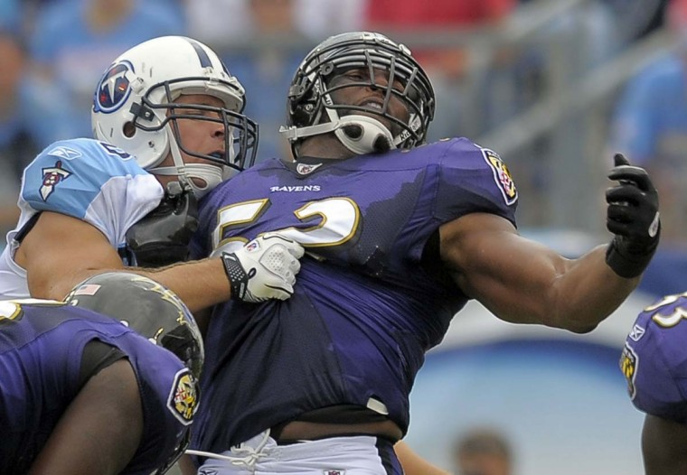 Tennessee tight end Craig Stevens tangles with Ray Lewis during the Titans' 23-16 win over the Ravens on Sept. 18, 2011. (Karl Merton Ferron/Baltimore Sun Photo)