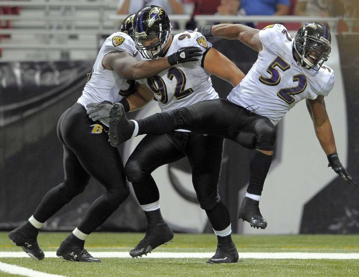 Haloti Ngata (92) is mobbed by Ray Lewis (52) and Terrell Suggs after a fumble recovery for a fourth-quarter touchdown against the St. Louis Rams on Sept. 25, 2011. The Ravens won, 37-7. (Karl Merton Ferron/Baltimore Sun Photo)