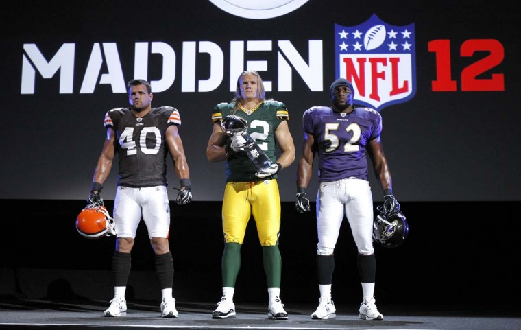 From left, Cleveland Browns running back Peyton Hillis, Green Bay Packers linebacker Clay Matthews and Ray Lewis promote the Madden NFL 12 video game at an event in Los Angeles. (Mario Anzuoni/Reuters)