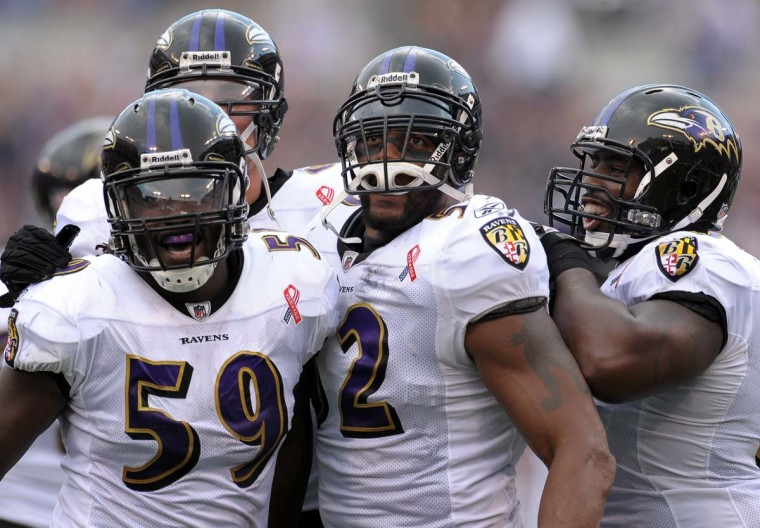Ravens Dannell Ellerbe (59), Paul Kruger (back), and Arthur Jones (right) surround Ray Lewis after he recovered a fumble against the Pittsburgh Steelers on Sept. 11, 2011. Baltimore routed the Steelers in the season opener, 35-7. (Gene Sweeney Jr./Baltimore Sun Photo)