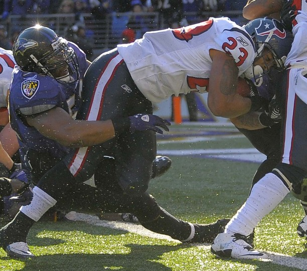 Ray Lewis tries to slow Texans running back Arian Foster during the Ravens' 29-14 win on Oct. 16, 2011, at M&T Bank Stadium. (Karl Merton Ferron/Baltimore Sun Photo)