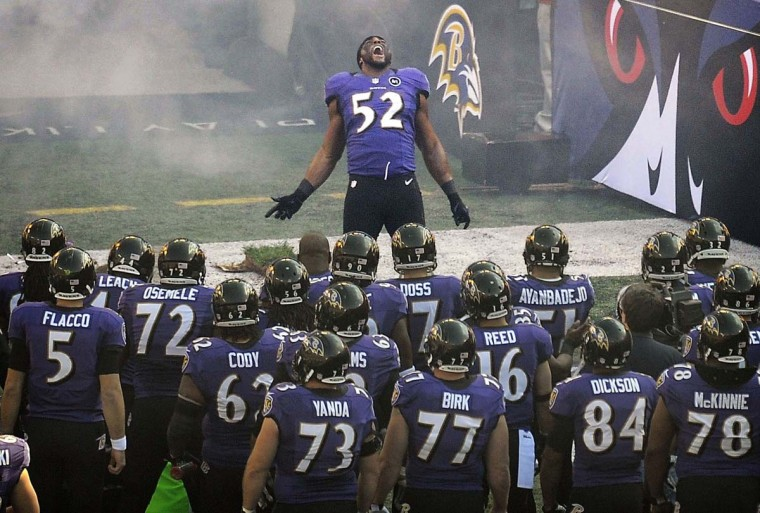 Ravens players watch as Ray Lewis is introduced before his final home game on an emotional day at M&T Bank Stadium. Lewis recorded a game-high 13 tackles as the Ravens beat the Indianapolis Colts, 24-9, in an AFC wild card game. (Gene Sweeney Jr./Baltimore Sun)