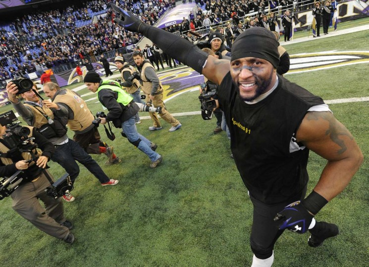 Following the 24-9 playoff win over the Colts, Ray Lewis salutes Ravens fans while taking a post-game victory lap around the stadium, bringing back memories of Orioles legend Cal Ripken Jr.'s jog around Camden Yards when he broke Lou Gehrig's streak. (Gene Sweeney Jr./Baltimore Sun Photo)