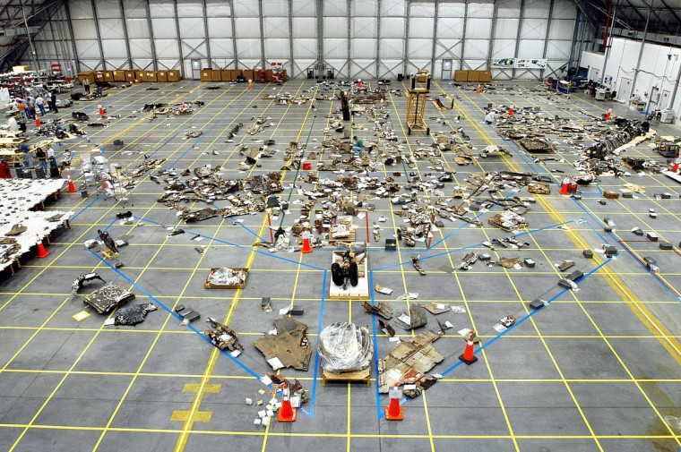 In this NASA handout, Columbia Space Shuttle debris lies floor of the RLV Hangar May 15, 2003 at Kennedy Space Center, Florida. More than 82,000 pieces have been delivered to the space center with 78,760 having been identified. (NASA/via Getty Images)