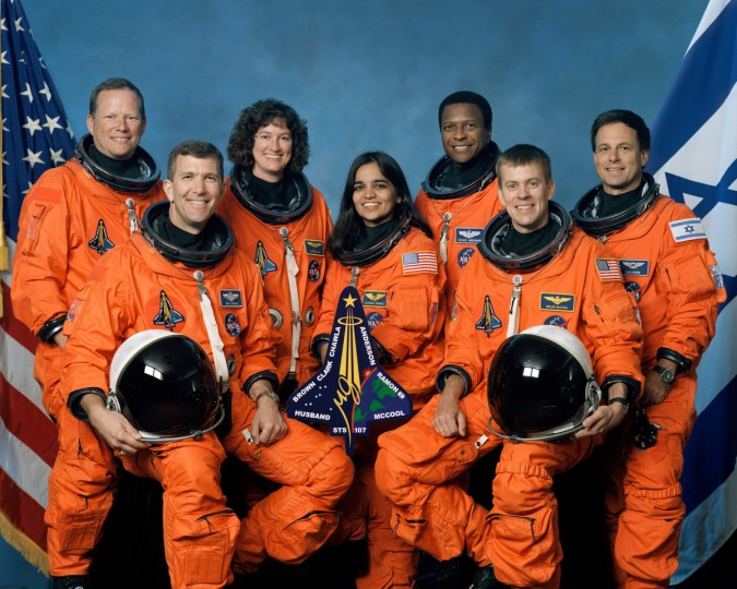 The crew of Space Shuttle Columbia's mission STS-107 take a break from their training regime to pose for the traditional crew portrait. Seated in front are astronauts Rick D. Husband (L), mission commander; Kalpana Chawla, mission specialist; and William C. McCool, pilot. Standing are (L to R) astronauts David M. Brown, Laurel B. Clark, and Michael P. Anderson, all mission specialists; and Ilan Ramon, payload specialist representing the Israeli Space Agency. The one-year anniversary of the space shuttle Columbia disaster during re-entry will be marked February 1, 2004. (NASA photo/via Getty Images)