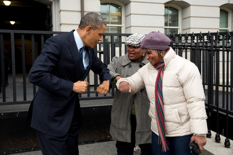 """Dec. 31, 2012: """"Following remarks in the Eisenhower Executive Office Building on the fiscal cliff negotiations, the President greets a couple of OMB workers as he walked back across on West Executive Avenue as he walked back to the West Wing of the White House. He gave them an elbow-bump, because he had just put Purell on his hands."""" (Official White House Photo by Pete Souza)"""