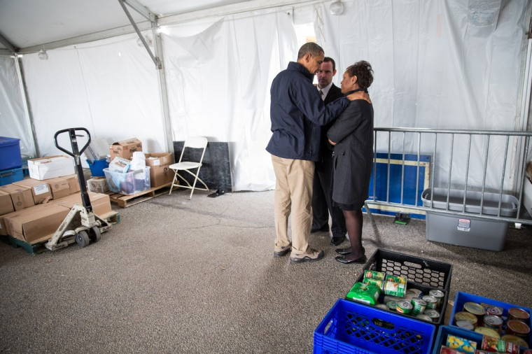 """Nov. 15, 2012: """"The President tries to comfort Damien and Glenda Moore at a FEMA Disaster Recovery Center tent in Staten Island, N.Y. The Moore's two small children, Brandon and Connor, died after being swept away during Hurricane Sandy."""" (Official White House Photo by Pete Souza)"""