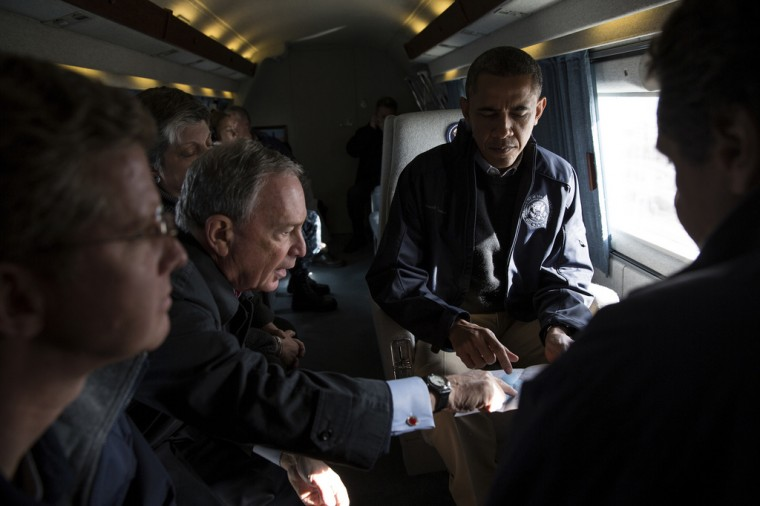 """Nov. 15, 2012: """"New York City Mayor Michael Bloomberg views a map with the President during an aerial tour to view damage from Hurricane Sandy in Breezy Point, the Rockaways and Staten Island in NYC. Also onboard were New York Gov. Andrew Cuomo, Shaun Donovan, Secretary of Housing and Urban Development, and Janet Napolitano, Homeland Security Secretary."""" (Official White House Photo by Pete Souza)"""