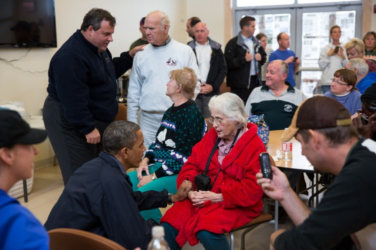 """Oct. 31, 2012: """"The President and New Jersey Gov. Chris Christie talk with local residents affected by Hurricane Sandy at the Brigantine Beach Community Center in Brigantine, N.J."""" (Official White House Photo by Pete Souza)"""