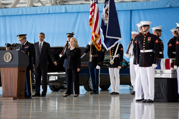 """Sept. 14, 2012: """"The President grasps the hand of the Secretary of State after his remarks during the ceremony at Joint Base Andrews, marking the return to the United States of the remains of J. Christopher Stevens, U.S. Ambassador to Libya; Sean Smith, Information Management Officer; and Security Personnel Glen Doherty and Tyrone Woods, who were killed in the attack on the U.S. Consulate in Benghazi, Libya."""" (Official White House Photo by Pete Souza)"""