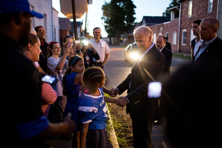 "Sept. 8, 2012: ""I love the headlight on the vehicle helping to light this frame taken by David Lienemann as the Vice President greets people gathered outside the Obama For America field office in Chillicothe, Ohio."" (Official White House Photo by David Lienemann)"
