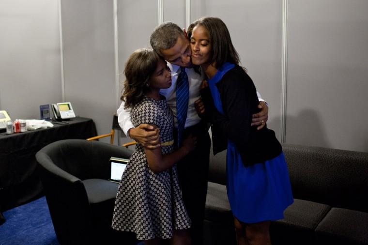 """Sept. 6, 2012: """"While the President was waiting anxiously backstage before his speech at the Democratic National Convention in Charlotte, N.C., daughters Malia and Sasha came in to wish him well."""" (Official White House Photo by Pete Souza)"""