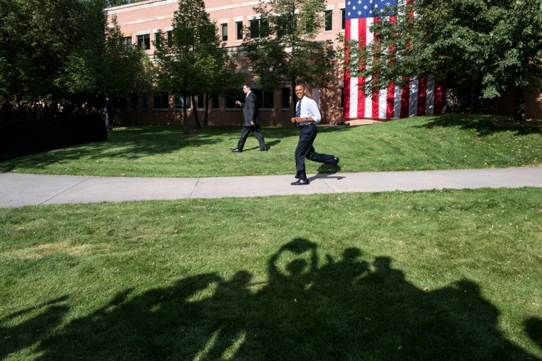 "Aug. 28, 2012: ""The shadows of supporters are seen cheering as the President makes his way to the stage at an outdoor campaign rally at Colorado State University in Fort Collins, Colo."" (Official White House Photo by Pete Souza)"