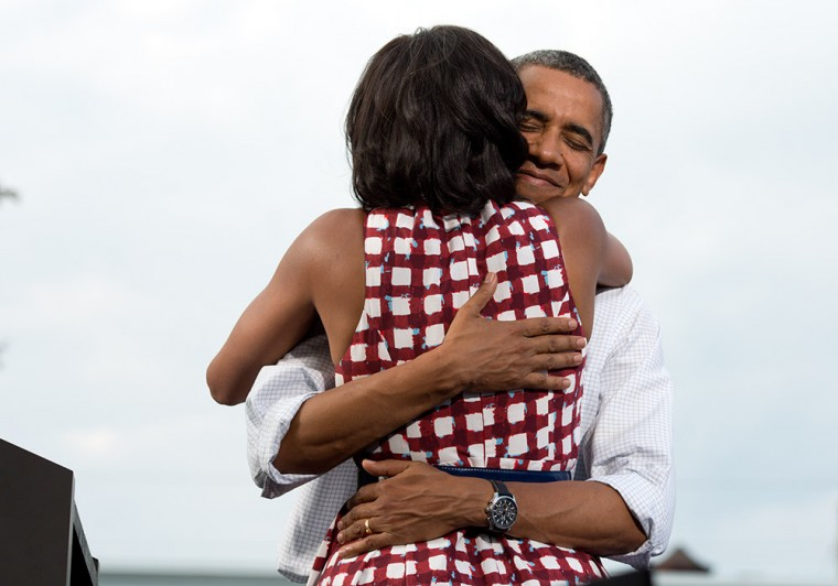 """Aug. 15, 2012: """"The President hugs the First Lady after she had introduced him at a campaign event in Davenport, Iowa. The campaign tweeted a similar photo from the campaign photographer on election night and a lot of people thought it was taken on election day."""" (Official White House Photo by Pete Souza)"""