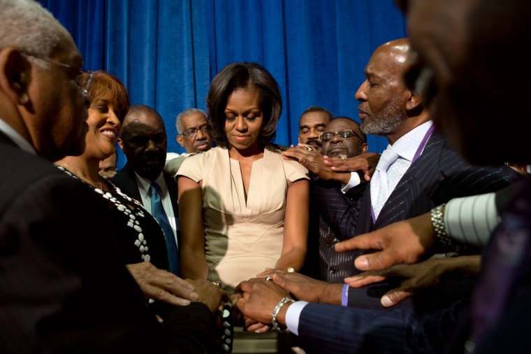 """June 28, 2012: """"Sonya Hebert made this photograph of the First Lady joining African Methodist Episcopal Church bishops for a group prayer at the Gaylord Opryland Resort in Nashville, Tenn."""" (Official White House Photo by Sonya N. Hebert)"""